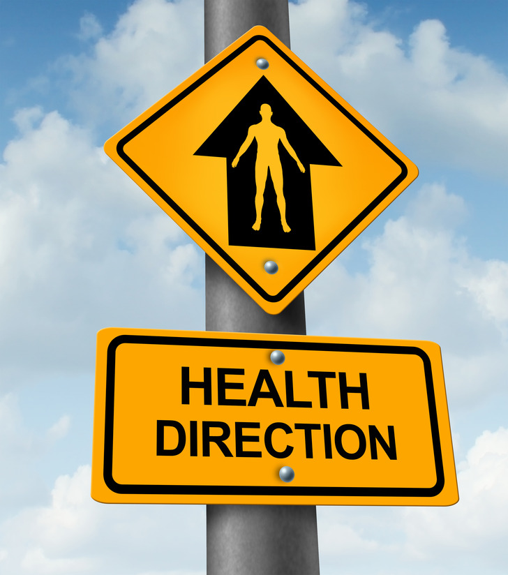 Health direction and living a healthy lifestyle medical concept as a yellow traffic sign with a human body arrow shape symbol representing doctor guidance based on future symptoms and diagnosis.